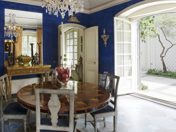 Farmhouse blue dining room with rectangular wooden table and chandelier