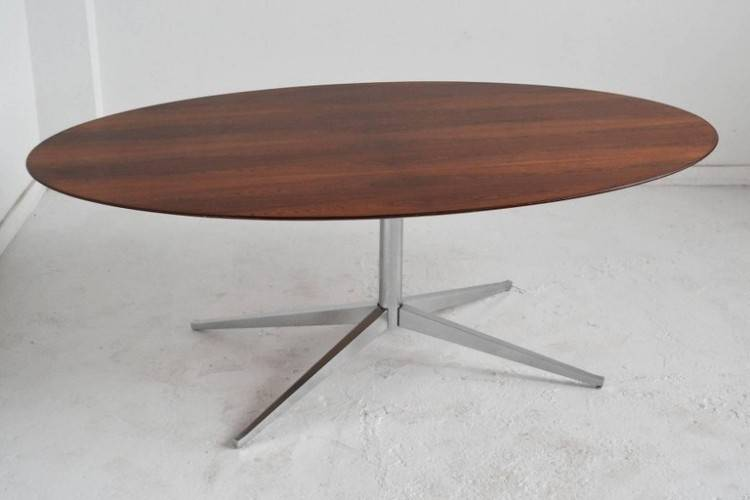 Elliptical oak dining table shown extended to seat 14